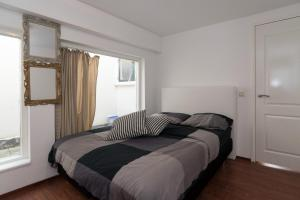 A bed or beds in a room at New Rijn Apartment