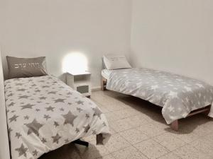 """A bed or beds in a room at three room apartment """"CITY"""""""