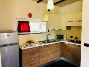 A kitchen or kitchenette at Residence Windsurf