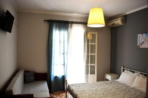 A bed or beds in a room at Apartments Despina