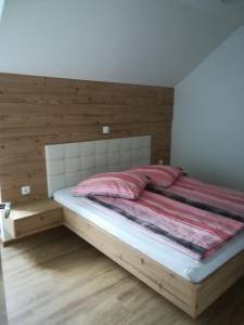 Postelja oz. postelje v sobi nastanitve Hiša Katja