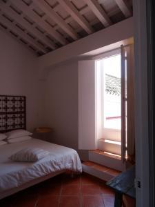 A bed or beds in a room at Apartamentos La Loba