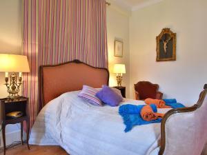 Un ou plusieurs lits dans un hébergement de l'établissement Holiday home Maison Amouroux