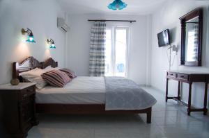 מיטה או מיטות בחדר ב-Erato Apartments