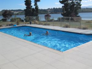 The swimming pool at or near Almyra Waterfront Accommodation