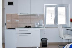 A kitchen or kitchenette at Apartment AneMare Kastela ~ Near by Split and Trogir