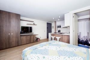 Cama ou camas em um quarto em Arauco Studio Apartment
