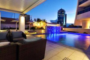 The swimming pool at or near H Resort Orchid Avenue Surfers Paradise- Holidays Gold Coast