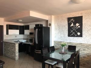 A kitchen or kitchenette at Apartments Veselinka