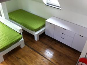 A bed or beds in a room at Apartments Podkoren