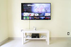 A television and/or entertainment centre at Heart of Sitges