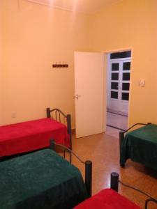 Una cama o camas en una habitación de Apartamento Catamarca 9 de Julio