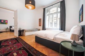 Ein Bett oder Betten in einem Zimmer der Unterkunft GRAND SOHO II Apartment Vienna