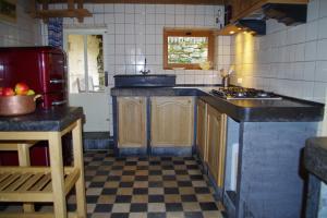Cuisine ou kitchenette dans l'établissement grand gîte louppy