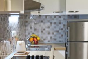 Kuchyň nebo kuchyňský kout v ubytování Modern Apartments Iva