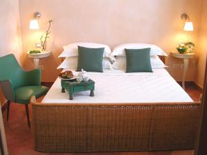 A bed or beds in a room at Artemura Residence