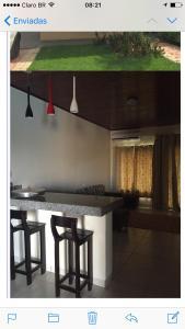 A kitchen or kitchenette at Sua casa fora de casa
