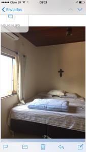 A bed or beds in a room at Sua casa fora de casa