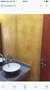 A bathroom at Sua casa fora de casa