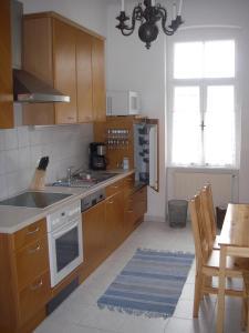 A kitchen or kitchenette at Ferienwohnungen Dr. Neubert