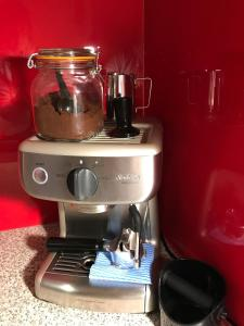 Coffee and tea-making facilities at Holly Cottage