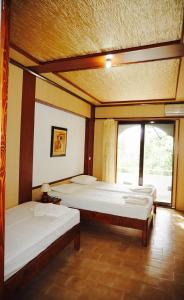 A bed or beds in a room at Damnoni Paradise