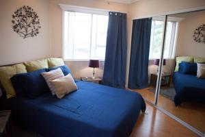 Ein Bett oder Betten in einem Zimmer der Unterkunft Hollywood 2Bed 2Bath