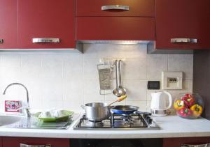 A kitchen or kitchenette at Monolocale Via Nino Oxilia
