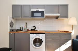 A cozinha ou cozinha compacta de Charming Apartment Near Beautiful Park