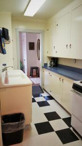 A kitchen or kitchenette at Coastal Heritage Accommodations