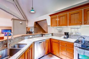 A kitchen or kitchenette at The Forest Neighborhood by Keystone Resort
