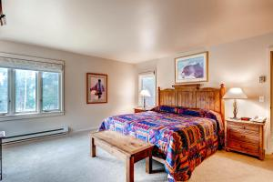 A bed or beds in a room at The Forest Neighborhood by Keystone Resort