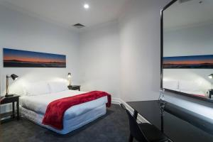 A bed or beds in a room at Heritage Apartment with all the extras