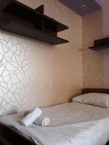 Łóżko lub łóżka w pokoju w obiekcie Apartament Kielce Fiolet