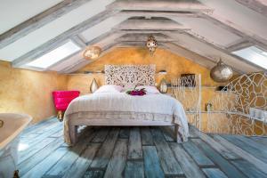 Postelja oz. postelje v sobi nastanitve La Dolce Vita Residence