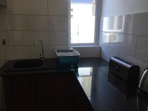 A kitchen or kitchenette at Appartement Résidence Adam Beau Manguier