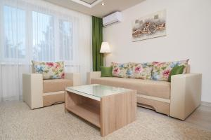 A seating area at Exotic Rami's Apartments
