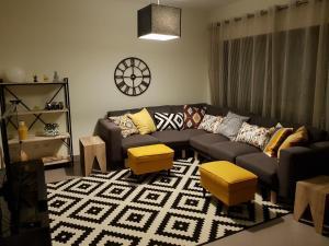 Uma área de estar em Casa de Casa