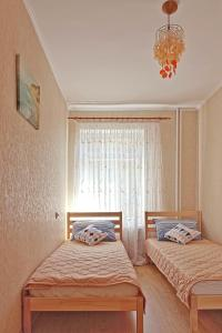 A bed or beds in a room at Apartment on Tomskaya 6