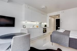A kitchen or kitchenette at Helsinki Homes Apartments