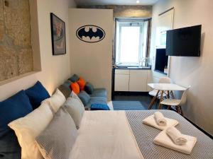 Uma área de estar em Ribeira Cinema Apartments