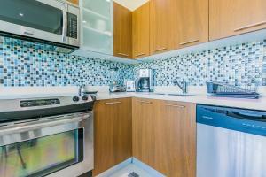 A cozinha ou cozinha compacta de Blue Residences