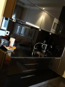 A kitchen or kitchenette at Roomspace Sandoval