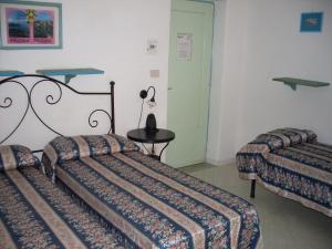 Letto o letti in una camera di Piccolo Tirreno Hotel Residence