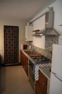 A kitchen or kitchenette at Casa Pignolo