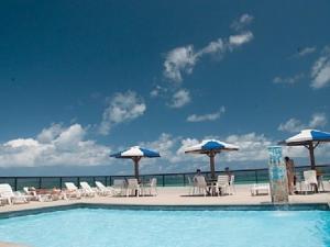 The swimming pool at or near Flat da Taci