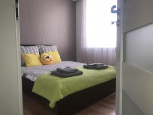 A bed or beds in a room at Sweet Dream Sienkiewicza