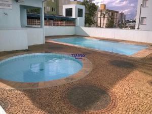 The swimming pool at or near Apartamento Inteiro em Campinas