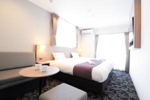 A bed or beds in a room at M-1 Tokyo Higashikojiya