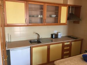 A kitchen or kitchenette at Prestige For Home-APT Alagoa Praia Altura